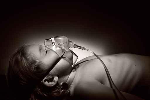 Little girl in mask of oxygen.